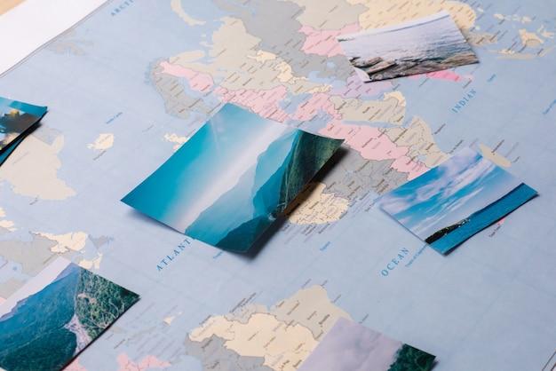 Крупный план красивых замечательных мест, отмеченных на карте мира, подготовка к поездке
