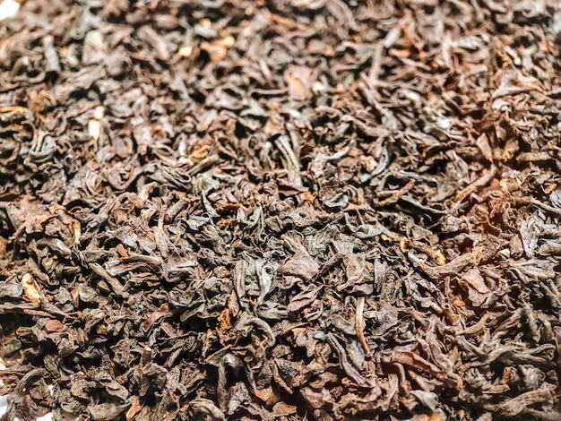 黒セイロンティーのテクスチャのクローズアップ。お茶の写真。