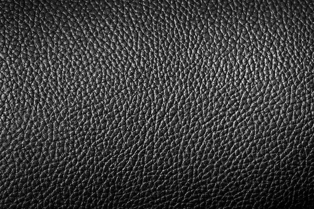 검은 가죽 질감의 클로즈업은 배경으로 사용할 수 있습니다.