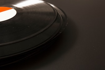 Close-up of black vinyl record on black background