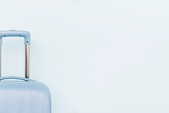 Close-up of blue luggage bag on white background