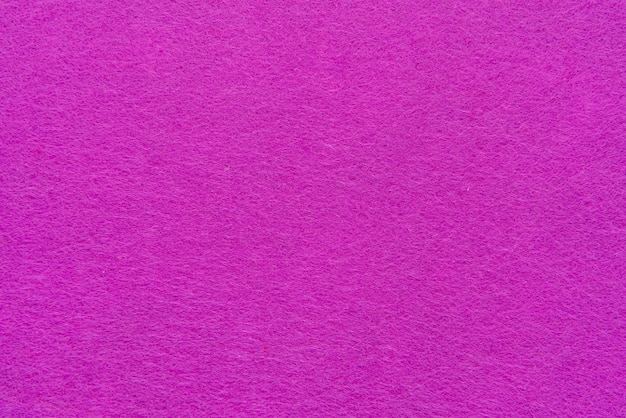 핑크 색상의 거친 양털 직물의 밝은 핑크 펠트 패브릭 질감의 닫습니다 거친 터치와 질감 펠트 직물의 강렬한 핑크 조각