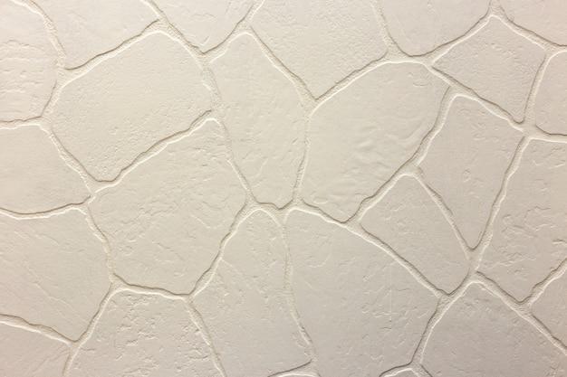 Конец-вверх яркой белизны заштукатурил неровную стену штукатурки. абстрактная текстура, хаотическая копия космический фон. декоративный гранж пространство.