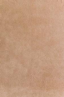 茶色の袋布のテクスチャの背景のクローズアップ