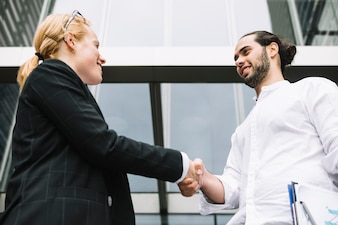 Close-up of business partners shaking hands