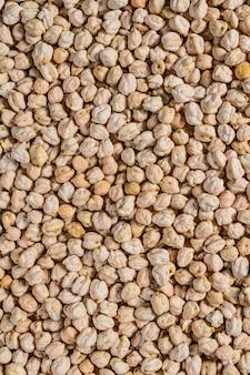 ひよこ豆のクローズアップ、高品質のテクスチャ。健康的なベジタリアン料理。上面図