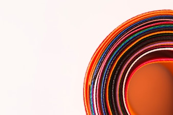 Close-up of colorful curved ribbons on white background