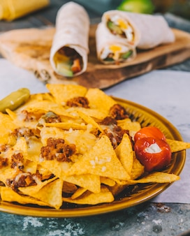 Close-up of delicious mexican nachos chips in plate