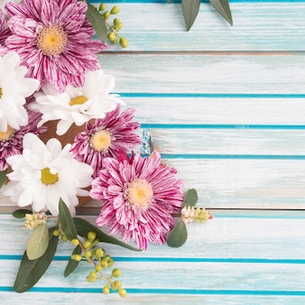 Close-up of flowers decoration on wooden background