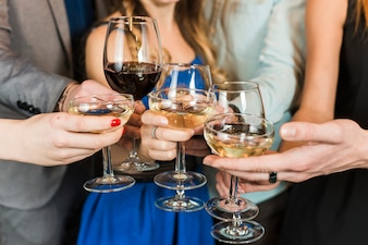 Close-up of friends toasting drinks at party