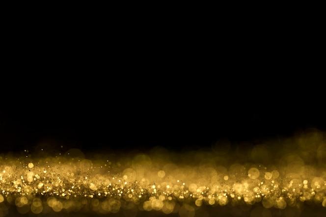 コピースペースで金色のキラキラのクローズアップ