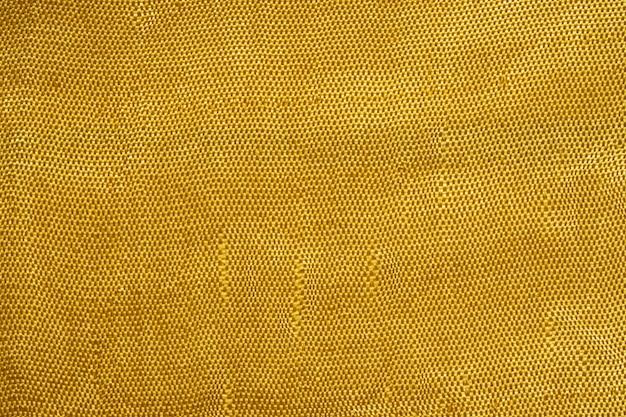金色のシルク生地の質感のクローズアップ