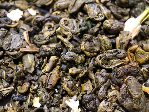 緑のセイロン茶のテクスチャのクローズアップ。お茶の写真。