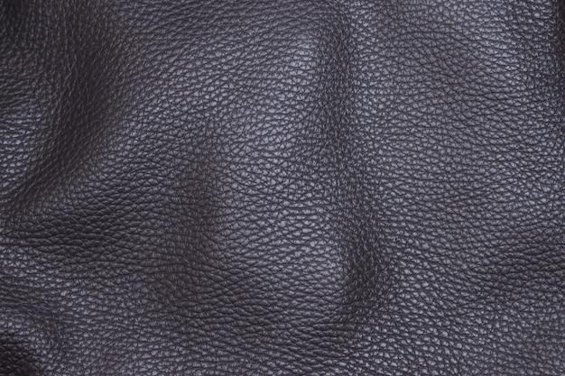 회색 검정 가죽 닫습니다. 배경, 섬유, 패턴.
