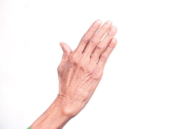 Крупным планом руки пожилого человека, изолированного на белом