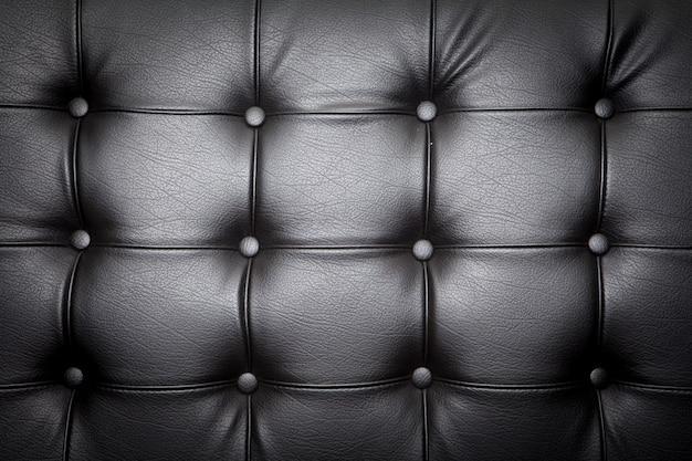 背景の革のソファのクローズアップ