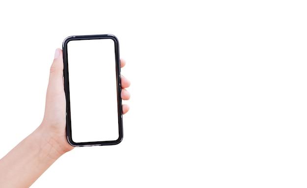 コピースペースと白で隔離のモックアップとスマートフォンを持っている男性の手のクローズアップ。