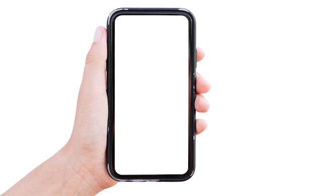 白で隔離のモックアップとスマートフォンを持っている男性の手のクローズアップ。