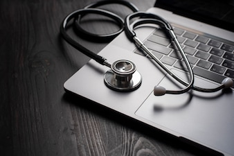 Close-up Of Medical Stethoscope On Laptop Keyboard