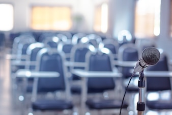 Close up of microphone in meeting room