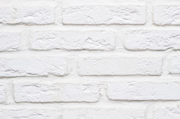 テクスチャードモダンな抽象的な白いレンガの壁のクローズアップ