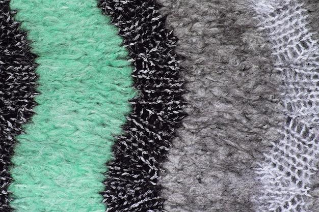 モヘア生地の織り目加工の布の背景のクローズアップ。ニット生地の質感
