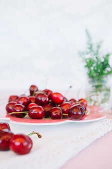 Close-up of napkin and cherries on plate