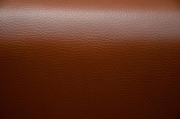 自然な茶色の革の背景のクローズアップ