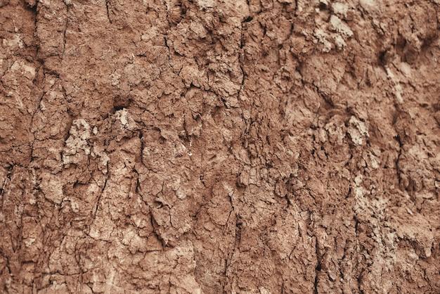 Крупный план натуральной коричневой каменной горной текстуры и фона