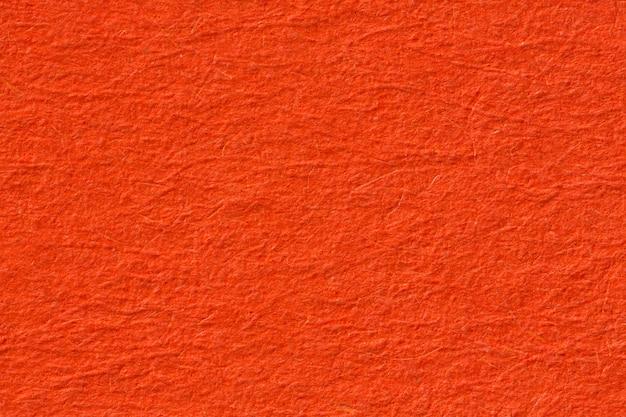 オレンジ色のテクスチャ背景、マクロ撮影のクローズアップ。高解像度の写真。