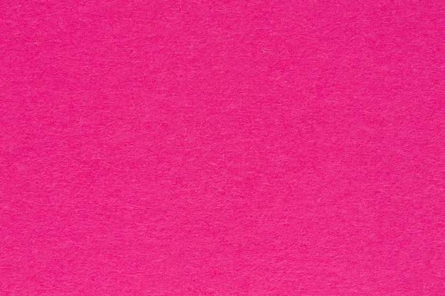 無地のピンクの背景のクローズアップ。高解像度の写真。