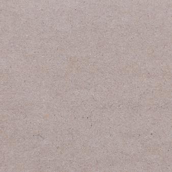 背景デザインのリサイクルされた茶色の紙のテクスチャのクローズアップ