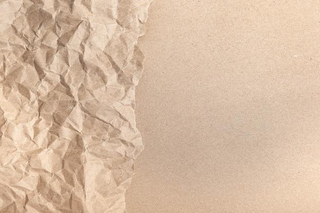 종이 페이지 질감 거친 배경으로 오래 된 구겨진 재활용 갈색 주름의 닫습니다. 주름 그런 지 양피지 패턴 포도주 디자인