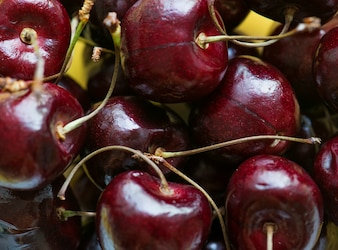 Close up of red cherries background