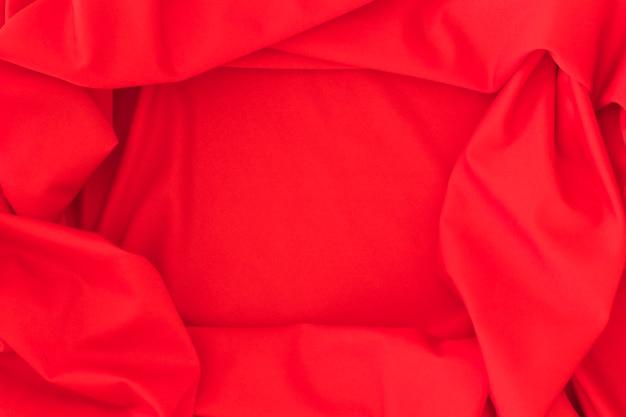 Крупный план красной ткани текстильного фона