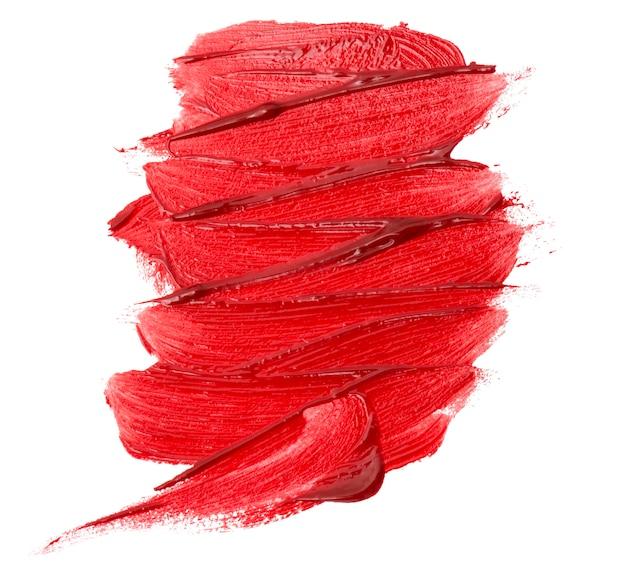 分離された赤い口紅テクスチャのクローズアップ