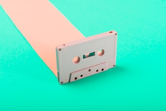 Close-up of retro cassette tape on blue background