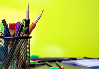 close-up of school tools on a yellow background