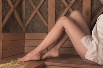 Close Up Of Sexy Womans Feet On Bench At Sauna