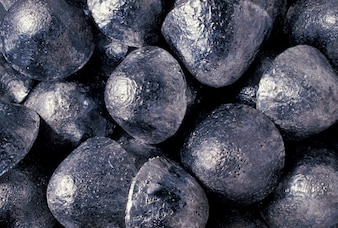Close up of silver buttons from silver mine