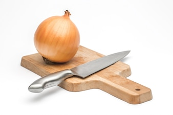 Close up of sliced Ripe onion and whole red onion on a wooden table.