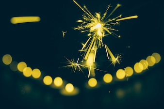 Close-up of sparkler on bokeh background