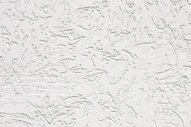 テクスチャの白いひびの入った壁のクローズアップ