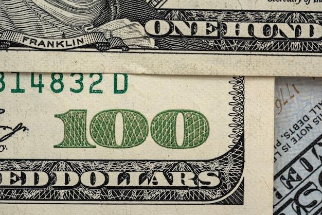米国の100ドル紙幣のファイナンスの概念のクローズアップ