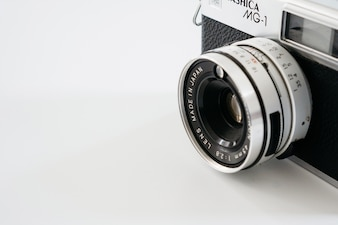 Close-up of vintage camera on white background