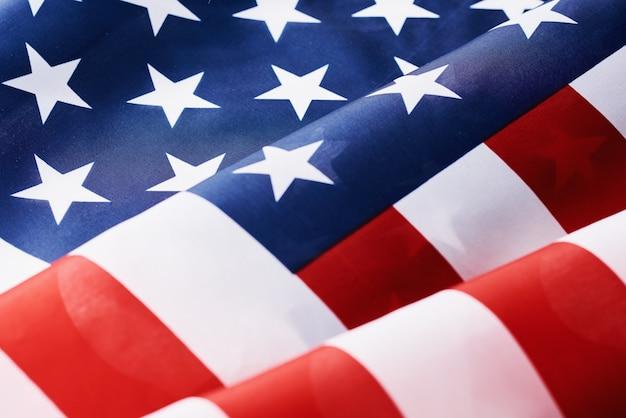 としてアメリカアメリカ国旗を振ってのクローズアップ、記念または独立記念日または7月4日の概念