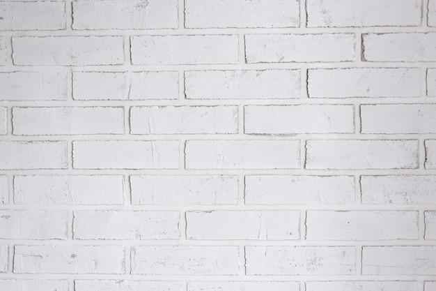 白いレンガの壁の背景とテクスチャのクローズアップ
