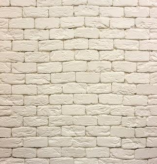 白く塗られた白塗りのレンガの壁の拡大図。コピースペースの背景、レンガ積み、建設、石積みのコンセプトを抽象化します。