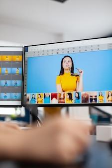 그래픽 태블릿에서 움직이는 스타일러스 연필을 들고 있는 여성 편집자 리터쳐 클로즈업