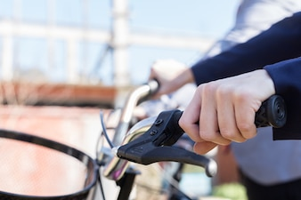 Close-up of woman's hand next to the bike brake